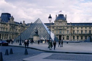 A photo I took of the Louvre. I am 100% certain that the Holy Grail is NOT situated under that pyramid in the centre left of frame. though the reception desk is.