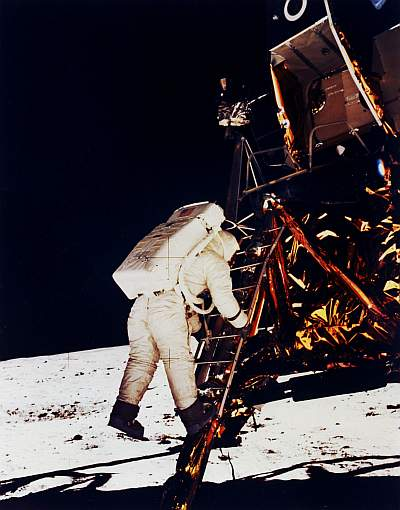 Buzz Aldrin descends to the lunar surface, 20 July 1969, illuminated by light reflecting from the regolith. Photo:NASA.