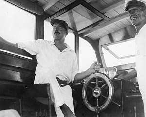 Ernest Hemingway (left) and Carlos Guiterrez, 1934. Public domain, via Wikimedia Commons.