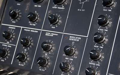 The panel of one of my analog synths... dusty, a bit scratched, but still workable.