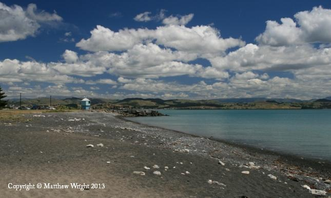 Greywacke brought down to the sea by the rivers that cross the Heretaunga plains give Napier's beaches their shingled look - and tint the summer sea azure.I went for full polarisation with this one to bring out the clouds, which the hills inevitably sweep into interesting shapes.