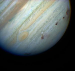 A Hubble picture of Jupiter after it had been machine-gunned by Comet Shoemaker-Levy in 1994. NASA, public domain, via Wikipedia.