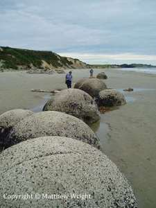 I took this photo of the Moeraki boulders in 2007. They fact that they are not perfect spheres is evident.