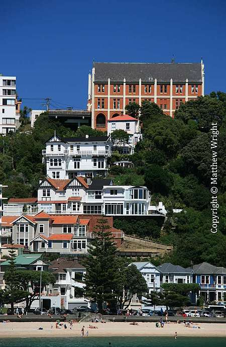 Brick monastery on Mount Victoria with the sandy beach of Oriental Bay below. The sand was imported from Golden Bay, all 30,000 tons of it.