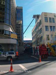 The dis-assembled crane in Luke's Lane - filling the lane - with the teetering lift shaft and 30-ton slab atop visible behind, propped up by another crane. Funny, why haven't the parking wardens ticketed the crane?