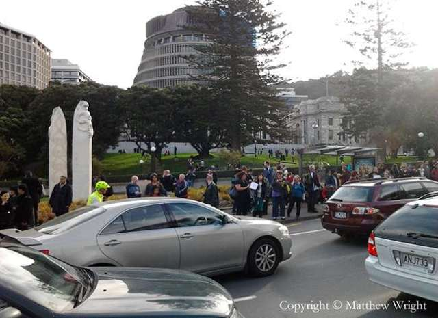 Pedestrians and cars at the bottom of Molesworth Street, Wellington, after the magnitude 6.6 shock of 16 August. Aftershocks up to 5+ magnitude were still rolling in when I took this.