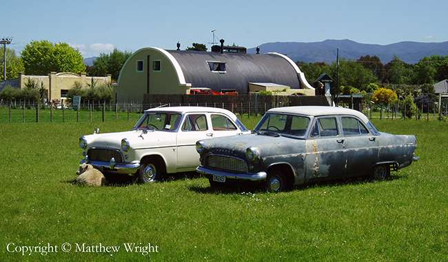 Two 1956 Ford Consuls out to seed. You can tell it's New Zealand because of the sheep. These four-cylinder Dagenham-designed vehicles were the lesser version of the classic Ford Zephyr.