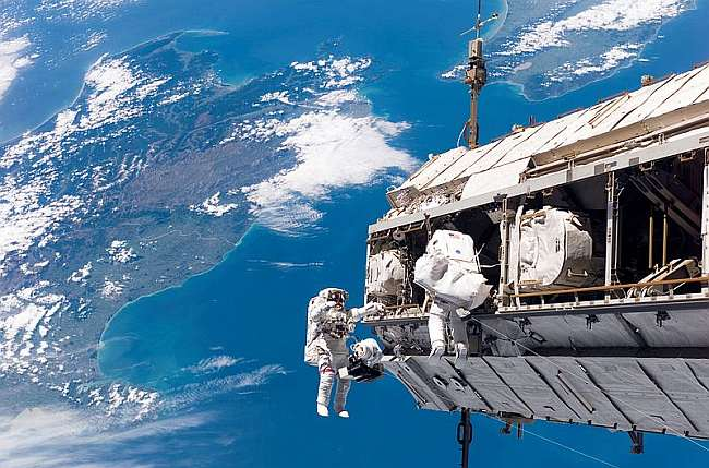 Spacewalk to assemble the ISS, 12 December 2006. New Zealand is below - North Island to the right, South to the left. My house is directly under the aerial centre-frame. Photo: NASA, public domain, via Wikipedia.