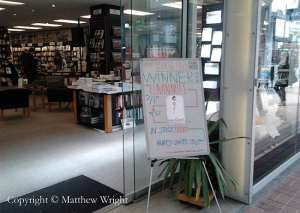 Board marking Catton's win in Unity Books, Wellington. Catton's book is in the window to the right (mine is in the window further along...heeey...)