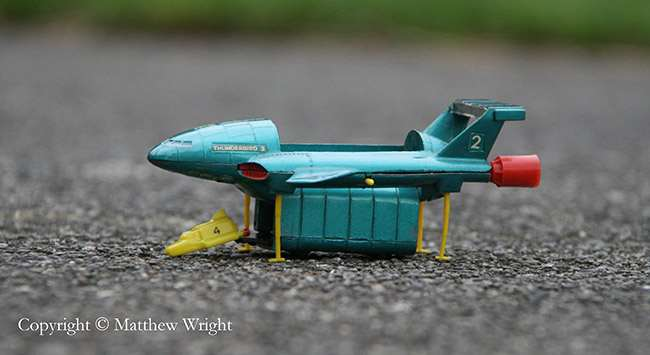 A photo I took of the Corgi Thunderbird 2 model I've had since forever... And it's not tilt-shift. This is what happens on a focal length of 190mm at f 5.6, natural light with exposure time of 1/100.