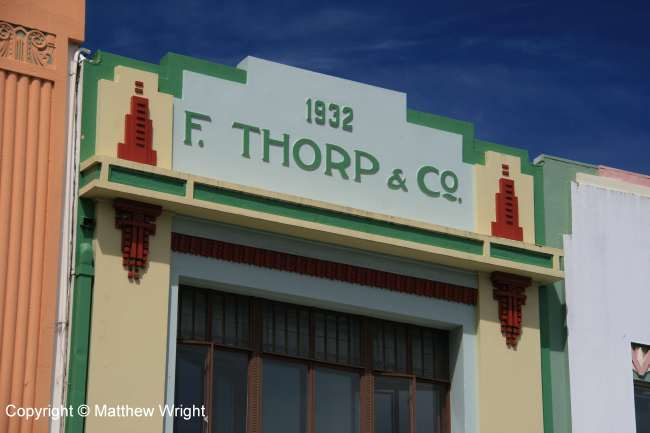Detail of the Thorp building. When I was a kid, this was a shoe store. Then it became a coffee shop. Now it's empty and up for lease.