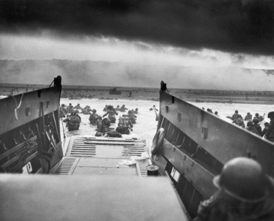 Landing at D-Day. Photo by Chief Photographer's Mate (CPHOM) Robert F. Sargent, U.S. Coast Guard. Public Domain.