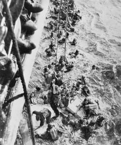 Survivors from Bismarck being pulled aboard HMS Dorsetshire, 27 May 1941. Public domain, via Wikipedia.