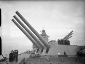 HMS Rodney's guns at full elevation. In May 1941, Rodney was the most powerful battleship in the world. Just not the fastest. Public Domain, via Wikipedia.