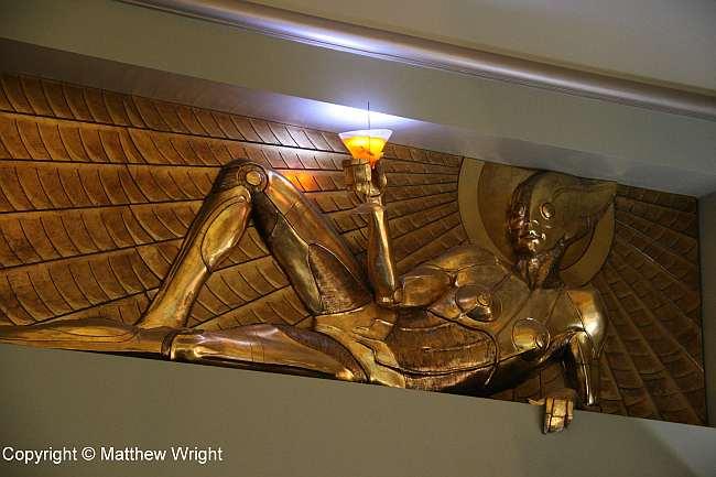 Dr Grordbort golden-age sci-fi frieze on the upper floor.