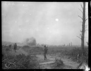 A shell bursting near New Zealand troops, Bailleul, World War I. Royal New Zealand Returned and Services' Association :New Zealand official negatives, World War 1914-1918. Ref: 1/2-013399-G. Alexander Turnbull Library, Wellington, New Zealand. http://natlib.govt.nz/records/23121937