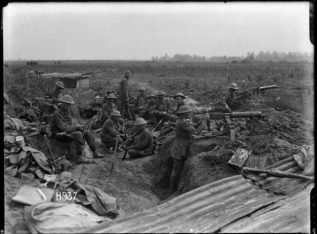 World War 1 New Zealand machine gunners using a captured German position, Puisiuex, France. Royal New Zealand Returned and Services' Association :New Zealand official negatives, World War 1914-1918. Ref: 1/2-013511-G. Alexander Turnbull Library, Wellington, New Zealand. http://natlib.govt.nz/records/22304585
