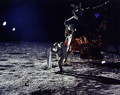 Buzz Aldrin on the Moon in July 1969 with the Solar Wind Experiment - a device to measure the wind from the sun. Public domain, NASA.