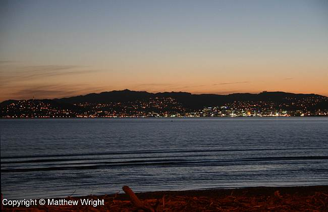 Sunset over Wellington from Petone beach.