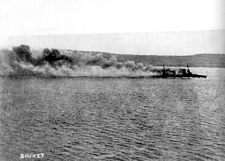 The old French battleship Bouvet sinking after striking a mine near the entrance to the Dardanelles, 18 March 1915. Public domain.