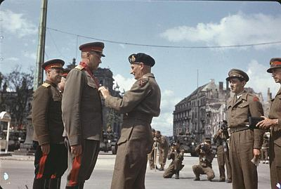 Field Marshal Sir Bernard Montgomery decorating Soviet Generals, Berlin, 12 July 1945. Public domain, via Wikipedia.