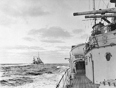 HMS Achilles early in the battle, seen from HMS Ajax. Public domain, via Wikipedia.