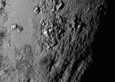 Close-up of the surface of Pluto - the Norgay Montes, named after Tenzing Norgay who, with New Zealander Edmund Hillary, was first to climb Everest in 1953.