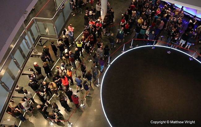 Queues waiting to get in to the 'Scale of our war' exhibition, April 2015.