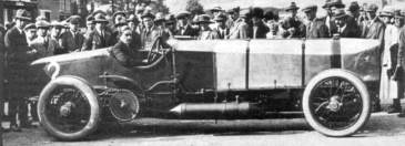 Count Louis Zborowski in 'Chitty Bang Bang 1' at Brooklands, around 1914. This huge, crude aero-engined racer sported chain drive - and look at the size of the front sprocket.