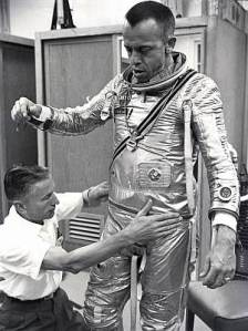 Alan Shepard being dressed in a Mk IV Navy Suit - the pressure garment used for the initial Mercury missions of the early 1960s. The aluminised outer fabric defined the popular 'look' of an astronaut. NASA, public domain, via Wikipedia.