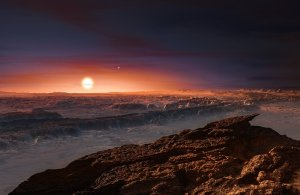 This artist's impression shows a view of the surface of the planet Proxima b orbiting the red dwarf star Proxima Centauri, the closest star to the Solar System. The double star Alpha Centauri AB also appears in the image to the upper-right of Proxima itself. Proxima b is a little more massive than the Earth and orbits in the habitable zone around Proxima Centauri, where the temperature is suitable for liquid water to exist on its surface. Credit: ESO.