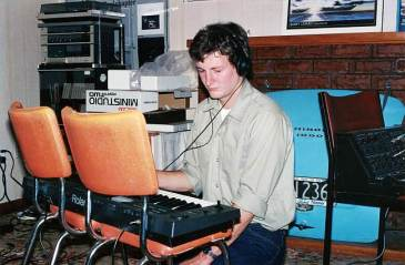 Playing my Roland Alpha Juno in my mis-spent youth (notice the Morris Minor boot lid behind me).