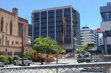 Building at 61 Molesworth Street being taken down by an 85-ton 'nibbling' crane.